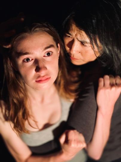 Marcia (Shawn Oda) holds Lavinia (Isabel Langen)